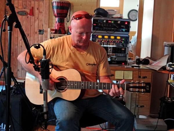 Don playing John's guitar